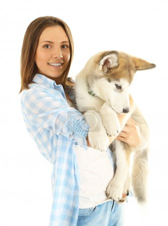 Young woman with malamute puppy