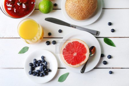 Photo for Healthy breakfast with fruits and berries on table close up - Royalty Free Image
