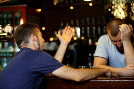 Photo for Young drunk man in bar - Royalty Free Image