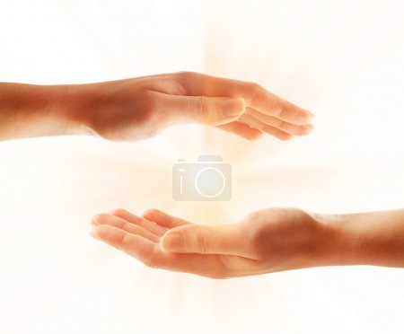 Human hands with light isolated on white