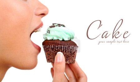 Closeup of woman eating chocolate cupcake