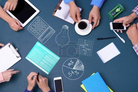 People hands in creative meeting.
