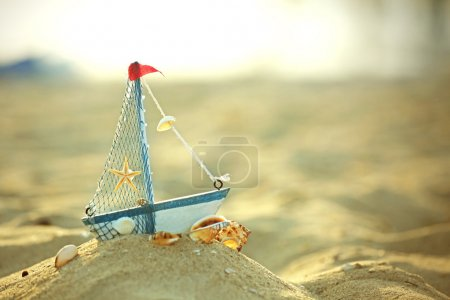 Photo for A little yacht on the seashore - Royalty Free Image