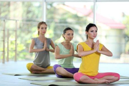 women meditating in yoga pose