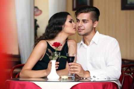 Attractive lady kisses man