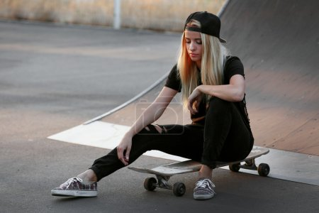 Young woman with skating board