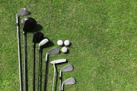 Different golf clubs in a row and balls