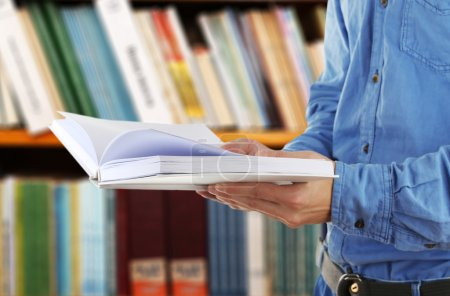 Male hands holding open book