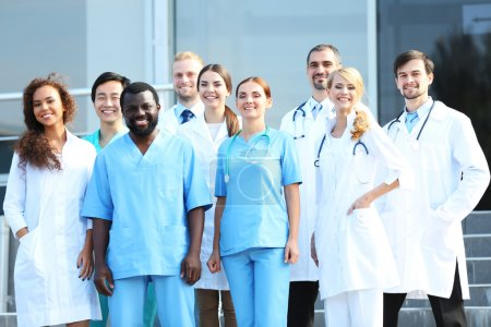 Smiling team of young doctors