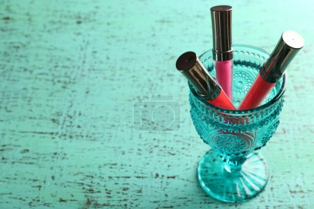 Make up lipsticks on wooden table