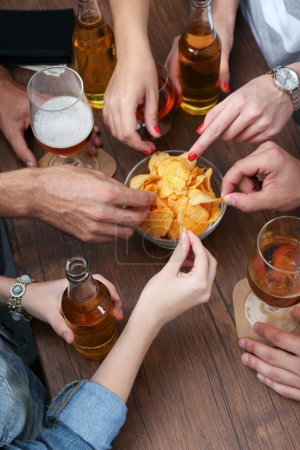 Photo for View on friends having alcoholic drinks in the bar, close-up - Royalty Free Image