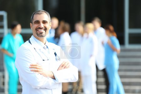 Happy doctor with medical stuff