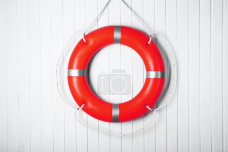 Lifebuoy on wooden wall