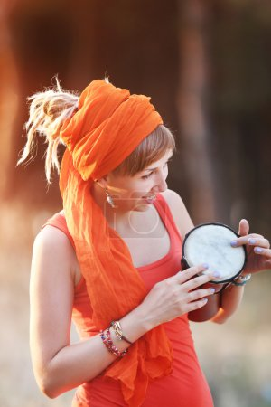 woman playing djembe