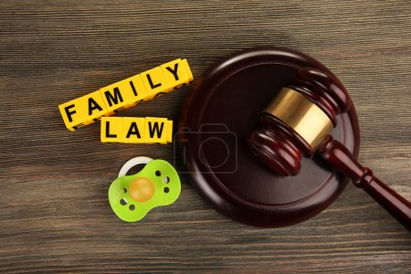 Photo for A gavel, a dummy and blocks regarding child-custody and divorce concept - Royalty Free Image