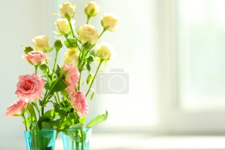 Beautiful spring flowers on soft window background close-up