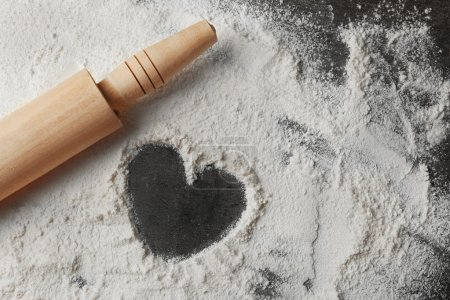 Photo for Heart of flour and rolling pin on gray background - Royalty Free Image