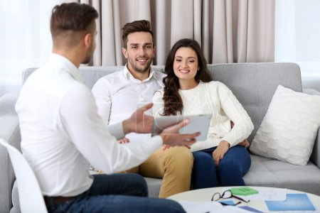 Estate agent presenting project to couple