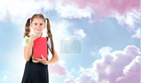 Schoolgirl on blue sky
