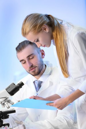 Medical technicians working in laboratory