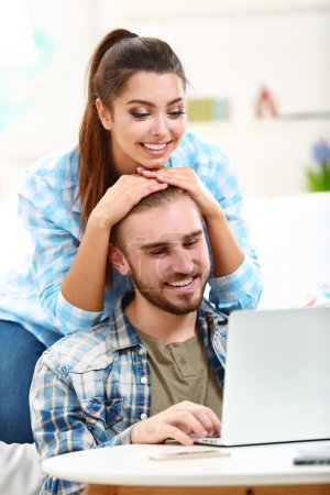 Couple working with a laptop at the table