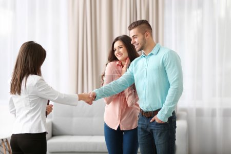 Man shaking hands with estate agent