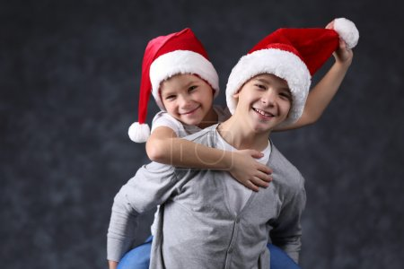 Brothers in Santa hats