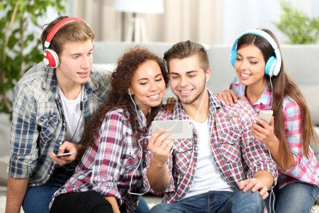 Two teenager couples listening to music
