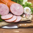 Ham sliced pork sausage  with sliced garlic and he...
