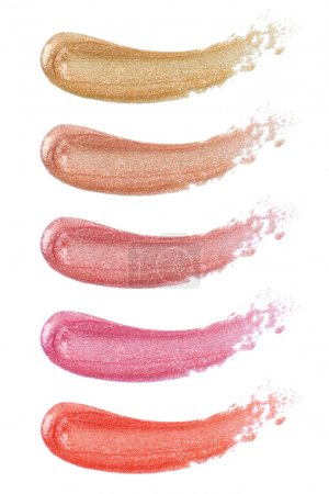 Different lip glosses isolated on white...