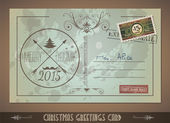 Vintage Postacard for Christmas greetings cards with postage stamps and festive text with fake address Retro design with distressed old look