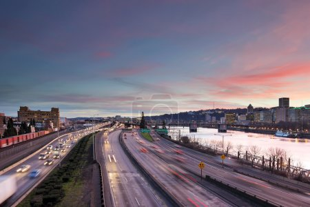 Photo for Portland Oregon rush hour traffic with city skyline along Interstate freeway during sunset evening - Royalty Free Image