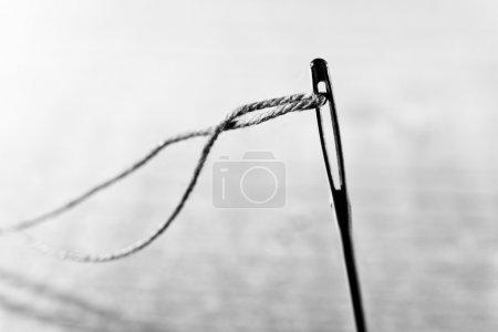 Photo for Detail of a needle with thread in the workroom, shallow depth of field - Royalty Free Image