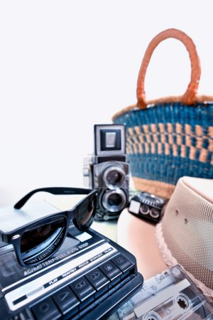 sunglasses and old twin-lens reflex camera