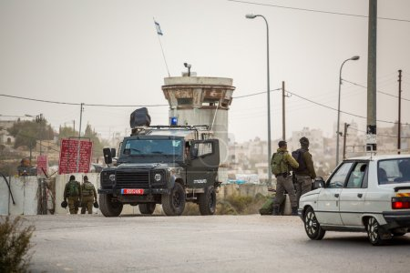Israeli soldiers checking Palestinians