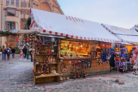 Decorated Christmas market stalls with traditional...