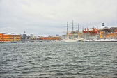 Evening scenery of the Old City of Stockholm with a ship in Sweden