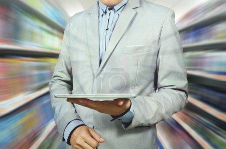 Business Man Holding Tablet in Supermarket outlet