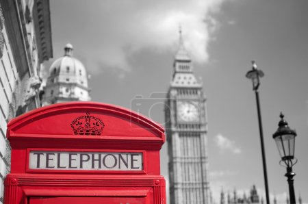 Photo for Close up of a red telephone box in London with Big Ben and Houses of Parliament in the background - Royalty Free Image