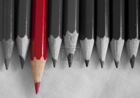 Photo for Stand out from the crowd.  Red pencil amongst a row of pencils in black and white - Royalty Free Image