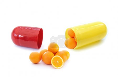 Photo for Miniature oranges inside a vitamin pill capsule - Royalty Free Image