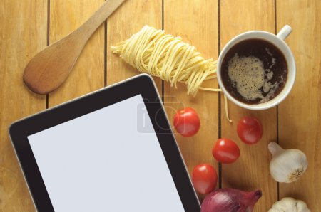 Photo for Tablet with copyspace surrounded by fresh food ingredients - Royalty Free Image