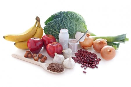Photo for Probiotic (or prebiotic) rich foods including pulses, nuts, fruit and milk products, good for immunity and the gut - Royalty Free Image