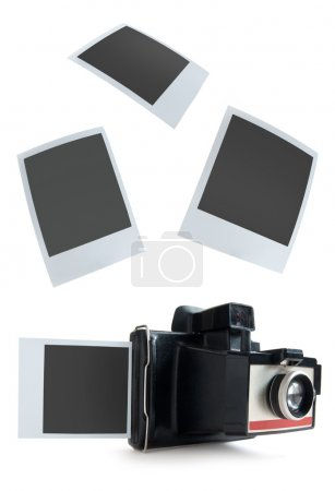 Photo for Polaroid instant camera with photos - Royalty Free Image