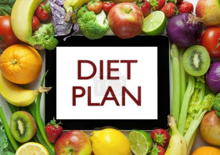 Foto de Frutas y verduras alrededor de un plan de dieta de tablet PC - Imagen libre de derechos