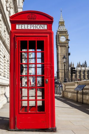 Photo for An iconic red Telephone Box with Big Ben in the background in London. - Royalty Free Image