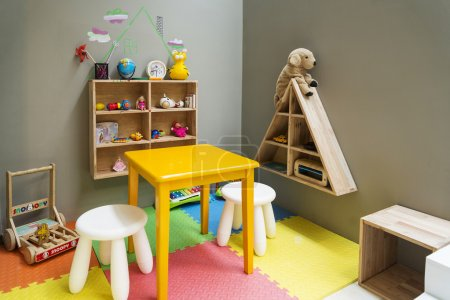 children play area with toys and furniture