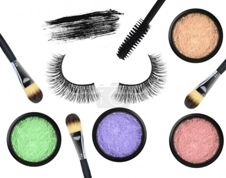 Black false eyelash, mascara, eyeshadows and brushes isolated on