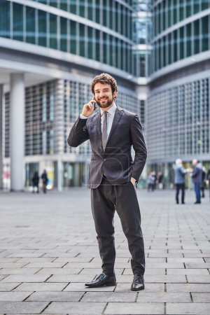 Photo for Young businessman talking to mobile - Royalty Free Image