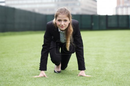 young businesswoman sprinting for career